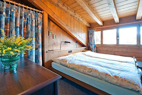 Suite Engiadina bedroom – Hotel Chesa Grischa in Sils-Baselgia