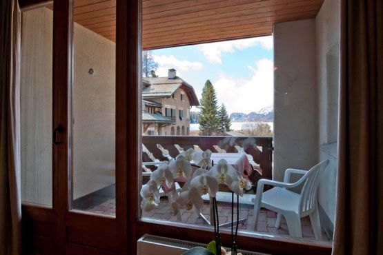 Junior suite with balcony view Marmotta – Hotel Chesa Grischa in Sils-Baselgia